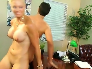 Fine looking slim milf Rhylee Richards with nice fake tits finds her...