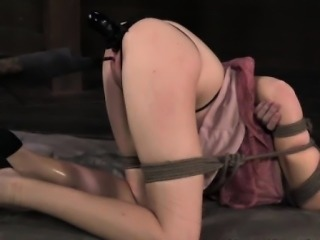 Restrained blonde sub with butt plug handling electrosex
