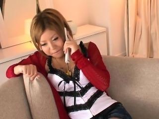 Naughty Asian girl masturbates while she talks on the phone