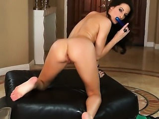 Kortney Kane with massive tits and trimmed beaver is totally naked and plays...