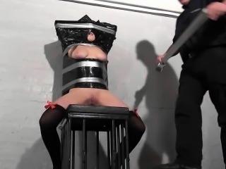 Restrained Taylor Hearts plastic bondage