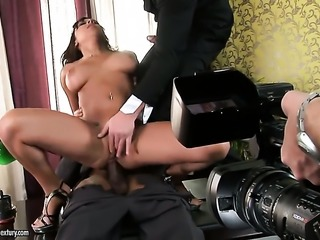 Brunette does lewd things in anal action