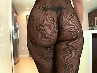 Brunette Latina is in her stockings in this video. She is shaking her huge...