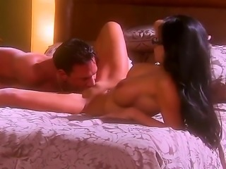 Mikayla Mendez is a Latina with long black hair. She is on the bed with a...