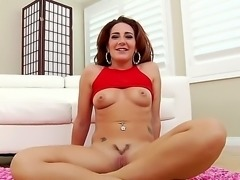 Savannah Fox is a chick with nice natural tits. The solo girl is sitting on...