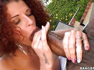 Ebony girl is giving a blow job