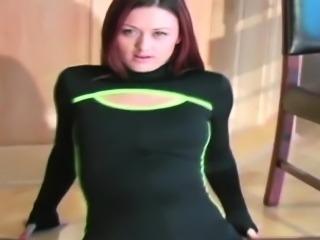 Sexy redhead Karlie Montana plays under her dark pantyhose