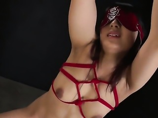 Saucy seductress goes solo for camera