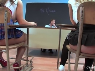 Two naughty schoolgirls have fun with their teacher