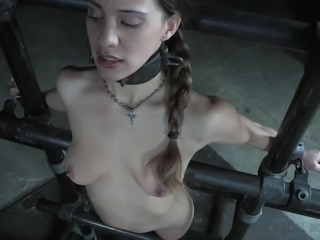 Devilynne is captured in a special device made of pipes and her body, is also...