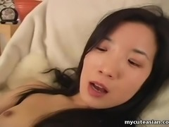 Cute Asian slut rubbing on her pussy and she cums