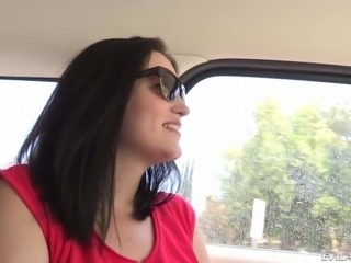 Long haired MILF brunette in shades spreads her legs in the car with her...