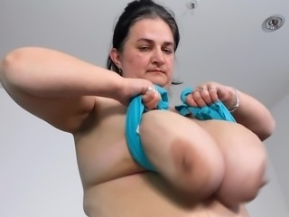 Busty mom swingers her boobs at home
