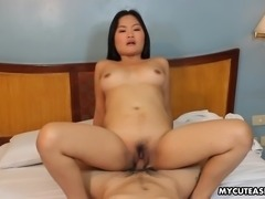 Medium sized Asian bitch rides a cock cow girl style