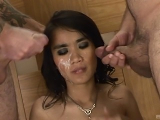 Thai girl threesome with a pair of cumshots covering her face
