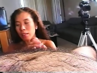 Kayako on her knees giving his knobby a good suck and swallowing