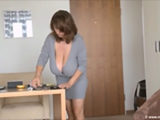 Busty MILF in a Grey dress plays with herself