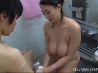 In the shower Japanese babe Nachi Kurosawa gives a soapy handjob