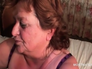 Horny mature gets pussy toyed and gives BJ