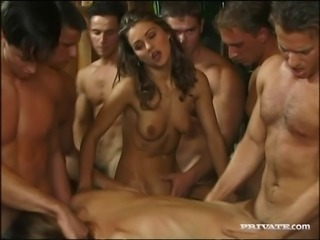 Vixenish babe with natural tits enjoys a wild groupsex party