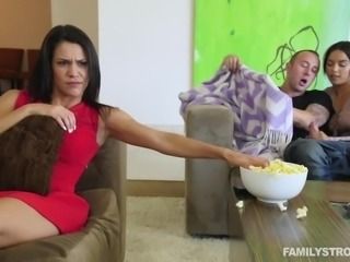 My cock was erected, but my wife was busy watching TV. Her cousin grabbed my...
