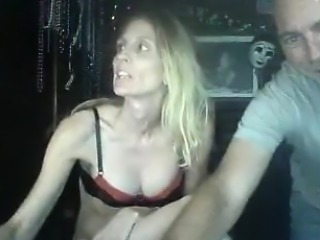 Slutty blonde whore showing her breasts while smoking about