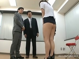 A naughty Japanese girl is punished by her bosses in the office