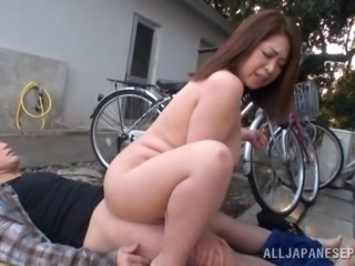 Mature Asian MILF gets so horny she rubs her pussy on a bike seat