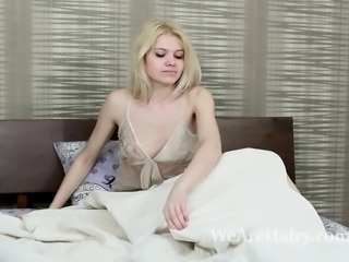 Amuza awakens in bed to strip and play naked