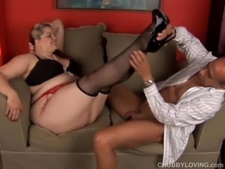 Kinky blonde BBW in stockings gives a sexy footjob