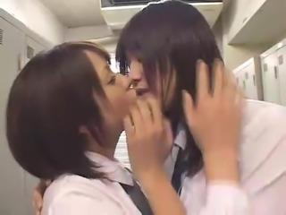 two japanese girls deep tongue kissing and sucking