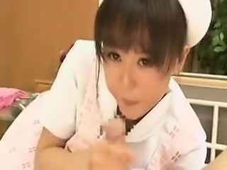 Enticing nurse gives a sublime blowjob and sensually caress