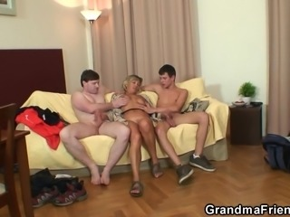 Two young guys bang pretty mom