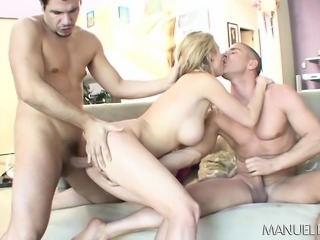 Busty blonde chomps on two pricks, takes it up the ass and eats cum