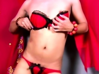 Ladyboy in red lingerie performs striptease and masturbation