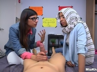 A busty Arab girl teaches another Arab girl how to give head