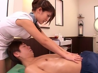 This Asian masseuse rubs her man down then gives him some pussy