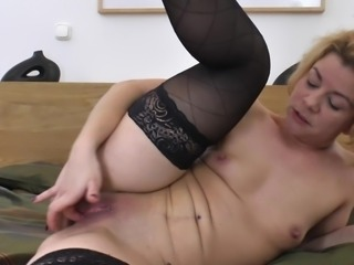 Mom with a clit ring plays with her pussy until she is all wet