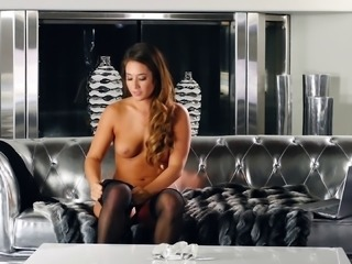 Alluring lady in stockings makes her pussy moist while rubbing it