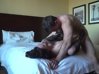 Black-haired cougar moans as the stallion ravages her inner depths