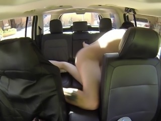Shaved pussy brunette with long hair giving dick blowjob in the car