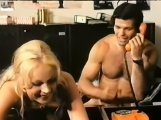 Sexy dude banging his lean blonde chick in the office