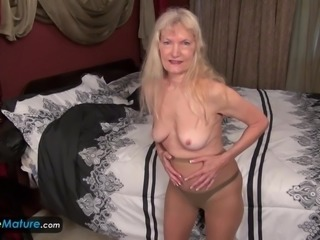 Old mature granny blonde small tits showing nipples masturbating hairy pussy...
