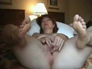 All horny and alone brunette MILF was fingering her own hungry pussy