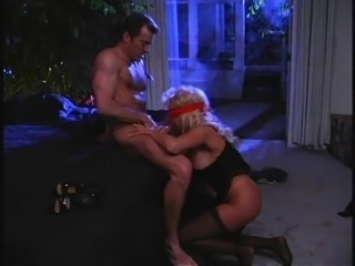 Spreading the legs of the blindfolded cougar and nailing her beaver