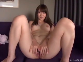 Japanese hottie removing her clothes to pose nude for us