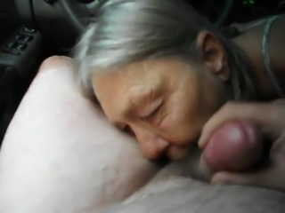 Time worn granny giving gumjob in a front seat in my car