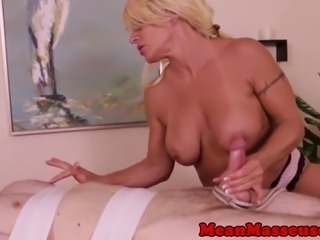 Dominating masseuse jerks and ruins orgasm