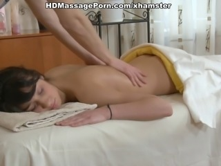 Naked girl gets under dirty sex massage from kinky man