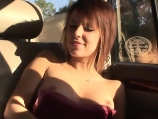 Irresistible redhead cutie masturbates in the car